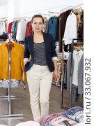 Купить «Woman standing in clothing boutique», фото № 33067932, снято 10 октября 2018 г. (c) Яков Филимонов / Фотобанк Лори