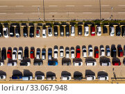 Купить «Top view of wide road with markings and lots of cars at day», фото № 33067948, снято 12 июля 2020 г. (c) Яков Филимонов / Фотобанк Лори