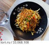 Купить «Japanese dish fried noodles Yakisoba», фото № 33068108, снято 20 февраля 2020 г. (c) Яков Филимонов / Фотобанк Лори