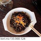 Купить «Japanese dish - seaweed salad with sesame seeds», фото № 33068124, снято 27 февраля 2020 г. (c) Яков Филимонов / Фотобанк Лори