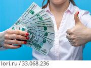 Купить «Hands of an unidentified woman with ruble banknotes», фото № 33068236, снято 12 марта 2019 г. (c) Pavel Biryukov / Фотобанк Лори