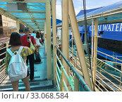 Купить «People get on ferry from Hong Kong to Macau», фото № 33068584, снято 15 сентября 2017 г. (c) Александр Подшивалов / Фотобанк Лори