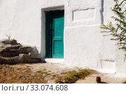 Купить «Entrance doors in the wall of the old house. Kerch, Crimea», фото № 33074608, снято 30 июня 2019 г. (c) Владимир Арсентьев / Фотобанк Лори