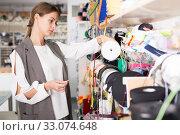 Купить «Girl choosing ribbons for needlecraft», фото № 33074648, снято 18 октября 2019 г. (c) Яков Филимонов / Фотобанк Лори
