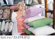 Купить «mature woman consumer with pillow», фото № 33074812, снято 29 ноября 2017 г. (c) Яков Филимонов / Фотобанк Лори
