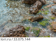 Pure clear water on a wild stone beach in the sea (2016 год). Стоковое фото, фотограф katalinks / Фотобанк Лори
