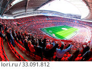 Купить «LONDON - APRIL 14 : Supporters watch the football game of Liverpool - Everton Semi Final FA Cup Crowd at Wembley Arena Staduim on April 14, 2012 in London, England United Kingdom.», фото № 33091812, снято 14 апреля 2012 г. (c) age Fotostock / Фотобанк Лори