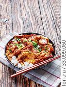 Oyakodon, Japanese Chicken and Egg Rice Bowl. Стоковое фото, фотограф Oksana Zh / Фотобанк Лори
