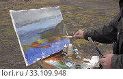 Купить «Painter draws brush oil paints on canvas mountains landscape, standing in open air in tundra», видеоролик № 33109948, снято 30 августа 2019 г. (c) А. А. Пирагис / Фотобанк Лори