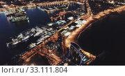 Купить «View from drone of illuminated Barceloneta beach with Port Vell t night», видеоролик № 33111804, снято 26 марта 2019 г. (c) Яков Филимонов / Фотобанк Лори