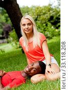 Купить «young enamored multicultural couple in a meadow», фото № 33118208, снято 25 мая 2020 г. (c) PantherMedia / Фотобанк Лори