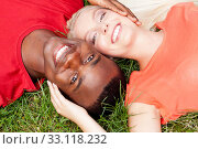 Купить «young amorous multicultural couple in a meadow», фото № 33118232, снято 25 мая 2020 г. (c) PantherMedia / Фотобанк Лори