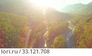 Купить «Low altitude flight over fresh fast mountain river with rocks at sunny summer morning.», видеоролик № 33121708, снято 4 апреля 2019 г. (c) Александр Маркин / Фотобанк Лори