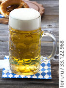 large glass of cold beer on a napkin. Стоковое фото, фотограф Thomas Klee / PantherMedia / Фотобанк Лори