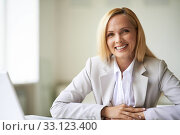 Купить «Young businesswoman looking at camera with toothy smile», фото № 33123400, снято 9 апреля 2020 г. (c) PantherMedia / Фотобанк Лори