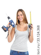 Beautiful woman holding a power drill and a tape measure. Стоковое фото, фотограф Antonio Guillen Fernández / PantherMedia / Фотобанк Лори
