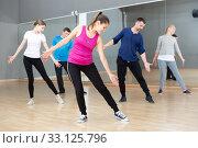 Купить «People stretching before dance training», фото № 33125796, снято 7 июля 2020 г. (c) Яков Филимонов / Фотобанк Лори