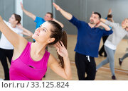 Young woman enjoying active dances. Стоковое фото, фотограф Яков Филимонов / Фотобанк Лори