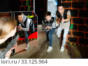 Lucky people aiming laser guns at other players. Стоковое фото, фотограф Яков Филимонов / Фотобанк Лори