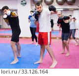 Adult men and women practicing boxing punches. Стоковое фото, фотограф Яков Филимонов / Фотобанк Лори