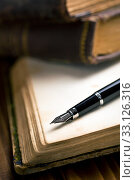 Купить «open book with fountain pen», фото № 33126316, снято 6 июня 2020 г. (c) PantherMedia / Фотобанк Лори