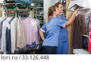 Купить «Two joyful workers of laundry during daily work», фото № 33126448, снято 9 мая 2018 г. (c) Яков Филимонов / Фотобанк Лори