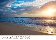 Купить «Sunset over the sea and the foam of the surf breaks on the sandy shore», фото № 33127680, снято 5 февраля 2010 г. (c) Куликов Константин / Фотобанк Лори