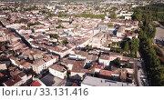 Купить «View from drone of small French town of Marmande with suspension bridge over Garonne river on summer day», видеоролик № 33131416, снято 18 июля 2019 г. (c) Яков Филимонов / Фотобанк Лори
