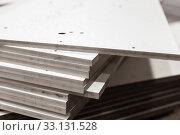 Купить «Stack of details made of white textolite sheets.», фото № 33131528, снято 10 февраля 2020 г. (c) EugeneSergeev / Фотобанк Лори