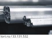 Купить «Assorted aluminum profile, industrial background», фото № 33131532, снято 10 февраля 2020 г. (c) EugeneSergeev / Фотобанк Лори