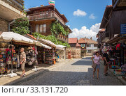 Купить «Souvenir shops on the street of the resort town of Nessebar. Elderly tourists look at souvenirs», фото № 33131720, снято 26 июня 2019 г. (c) Юлия Бабкина / Фотобанк Лори