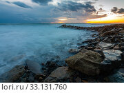 Купить «Seascape at sunset, waves roll ashore», фото № 33131760, снято 12 февраля 2020 г. (c) Иванов Алексей / Фотобанк Лори