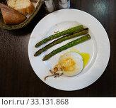 Купить «Fried sepia with baked asparagus», фото № 33131868, снято 26 февраля 2020 г. (c) Яков Филимонов / Фотобанк Лори