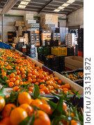 Купить «Production facilities of grading and packing of harvest of mandarins on an agricultural farm», фото № 33131872, снято 25 февраля 2020 г. (c) Яков Филимонов / Фотобанк Лори