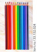 Купить «Colorful pencils on wooden table», фото № 33132024, снято 25 февраля 2020 г. (c) Яков Филимонов / Фотобанк Лори