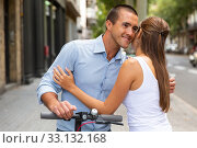 Couple hugging during riding together kick scooter in city center. Стоковое фото, фотограф Яков Филимонов / Фотобанк Лори