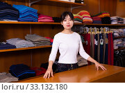 Купить «Chinese female shopping assistant offering various shirt in men's cloths store», фото № 33132180, снято 26 февраля 2020 г. (c) Яков Филимонов / Фотобанк Лори