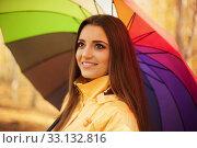 Купить «Smiling woman standing under the umbrella», фото № 33132816, снято 17 февраля 2020 г. (c) PantherMedia / Фотобанк Лори