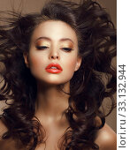 Купить «Sexy Woman with Long Windy Brown Hair and Saturated Makeup», фото № 33132944, снято 25 мая 2020 г. (c) PantherMedia / Фотобанк Лори