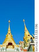 Golden pinnacle of thai temple. Стоковое фото, фотограф Yongkiet Jitwattanatam / PantherMedia / Фотобанк Лори