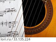 Купить «Classical guitar and notes», фото № 33135224, снято 31 мая 2020 г. (c) PantherMedia / Фотобанк Лори