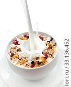 Купить «Milk splashing into a bowl of fresh muesli», фото № 33136452, снято 30 марта 2020 г. (c) PantherMedia / Фотобанк Лори