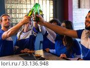 Купить «Supporters having fun together while drinking», фото № 33136948, снято 15 ноября 2019 г. (c) Wavebreak Media / Фотобанк Лори