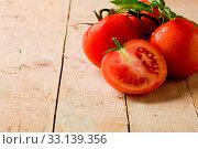 Купить «Photo of delicious fresh tomatoes with basil leaves on wooden table», фото № 33139356, снято 19 февраля 2020 г. (c) easy Fotostock / Фотобанк Лори