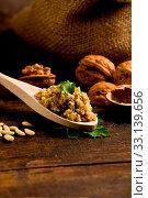 Купить «Photo of delicious fresh ingredients for walnut pesto on wooden table», фото № 33139656, снято 19 февраля 2020 г. (c) easy Fotostock / Фотобанк Лори