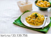 Купить «Delicious italian fresh tortellini with butter and sage on green wooden table», фото № 33139756, снято 19 февраля 2020 г. (c) easy Fotostock / Фотобанк Лори