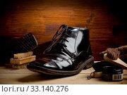 Купить «Photo of various brushes on wooden table used for polishing shoes», фото № 33140276, снято 21 февраля 2020 г. (c) easy Fotostock / Фотобанк Лори
