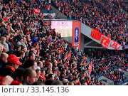 Купить «LONDON - APRIL 14 : Supporters watch the football game of Liverpool - Everton Semi Final FA Cup Crowd at Wembley Arena Staduim on April 14, 2012 in London, England United Kingdom.», фото № 33145136, снято 14 апреля 2012 г. (c) age Fotostock / Фотобанк Лори