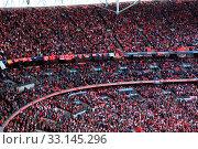 Купить «LONDON - APRIL 14 : Supporters watch the football game of Liverpool - Everton Semi Final FA Cup Crowd at Wembley Arena Staduim on April 14, 2012 in London, England United Kingdom.», фото № 33145296, снято 14 апреля 2012 г. (c) age Fotostock / Фотобанк Лори