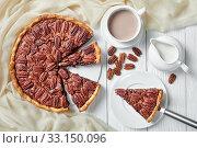 Купить «pecan pie sliced on a white platter», фото № 33150096, снято 19 ноября 2019 г. (c) Oksana Zh / Фотобанк Лори
